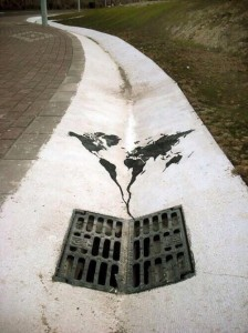 Graffiti of the planet being flushed down the drain